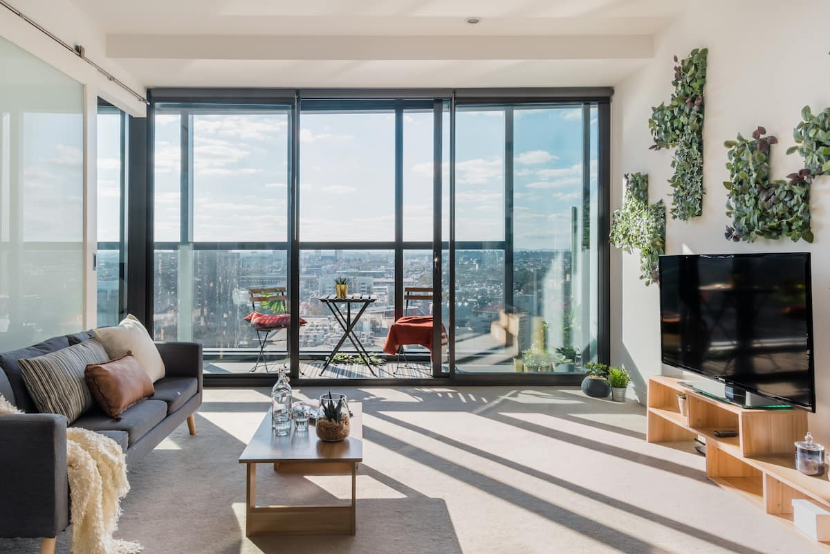 Revel In Melbourne's City Skyline from a Modernist Apartment