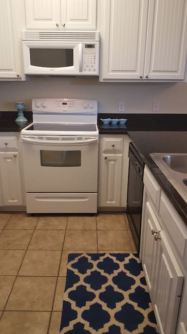 Our bright kitchen has a dishwasher, ice maker, and microwave. We have a toaster, coffee maker and blender.