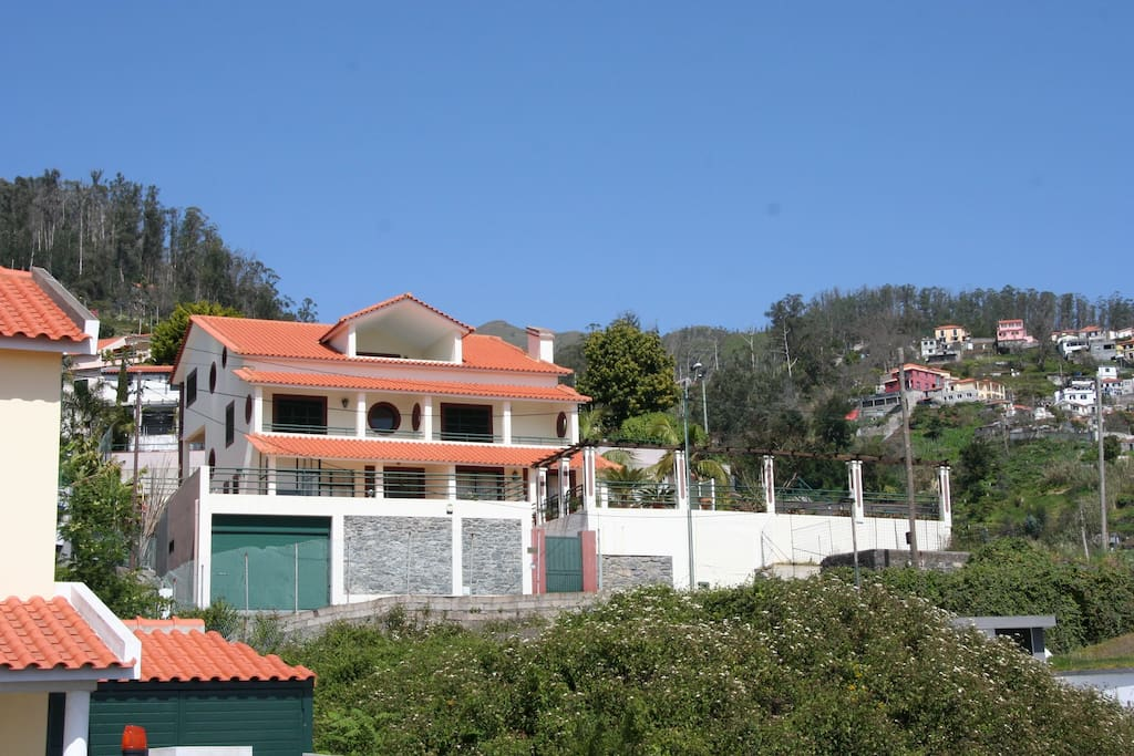 Frontal view of elevated private detached villa
