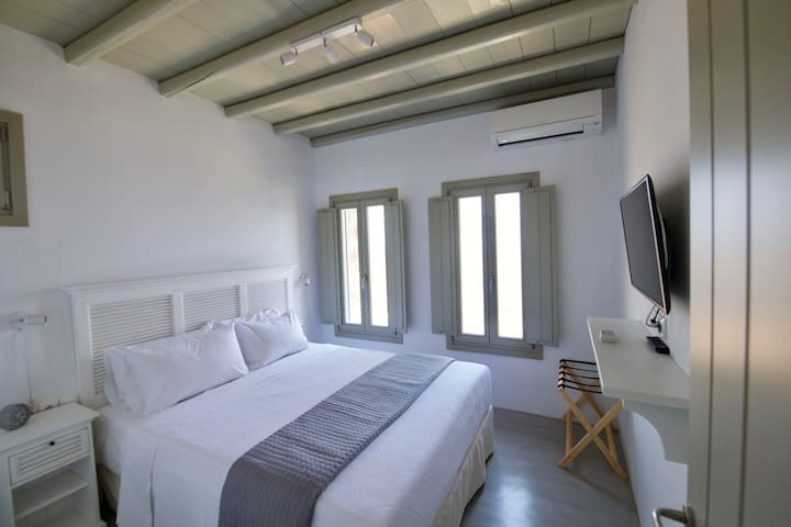 Bedroom with king size bed.