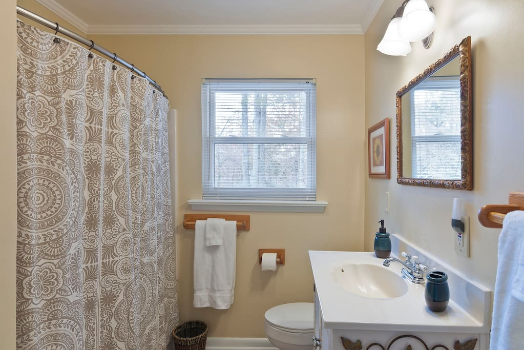 Private, Non-Shared Bath Across the Hall with Tub and Shower. Unlimited Hot Water. Includes Towels, Washcloths and Toiletries.