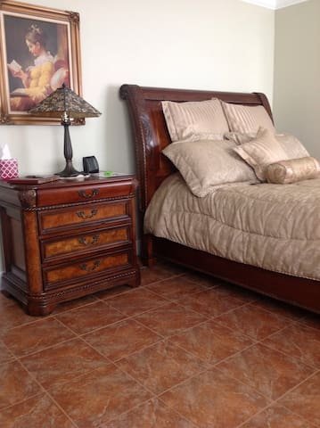 Beautiful hand carved bedroom set with burlwood inlay.