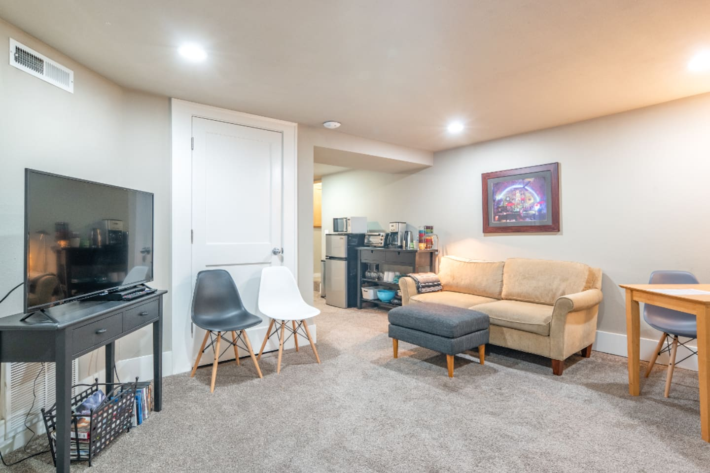 Private living room area with couch, Roku television and DVD player.