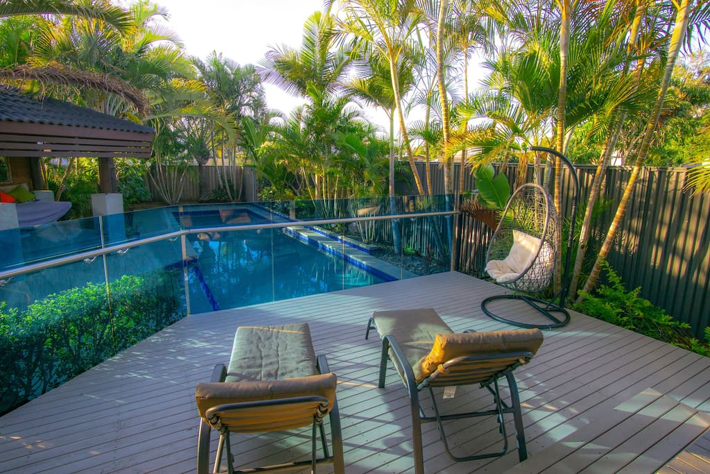 Private relaxed outdoor living surrounded by tropical gardens