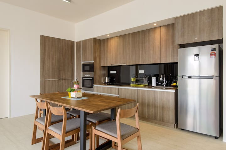 Dining and Kitchen with build in hood, stove, microwave, oven and water filter