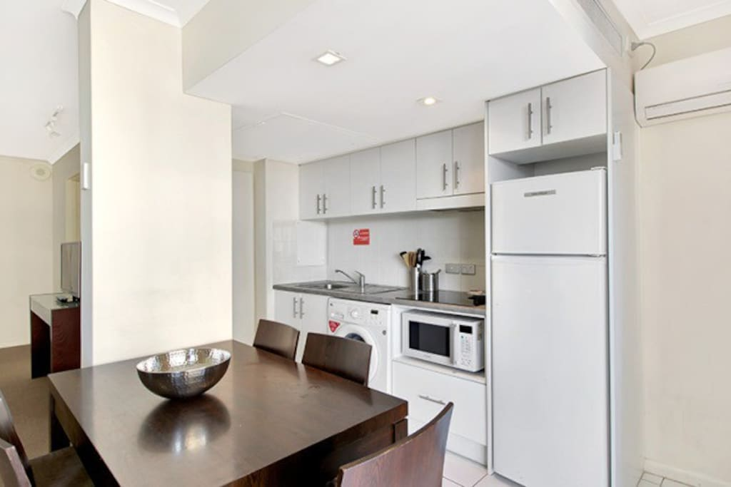 Equipped kitchen. There is also a washing machine in the kitchen. Communal dryers are located on the lower floors for all guest to use.