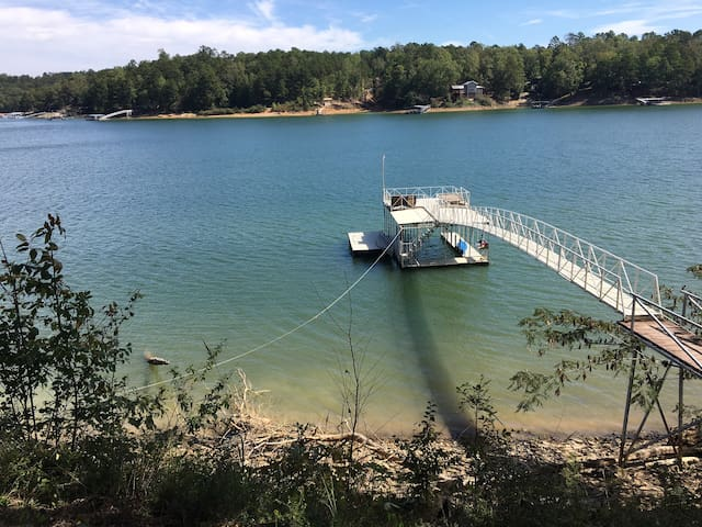 Over 200 feet of lake front with sun deck and swim pier