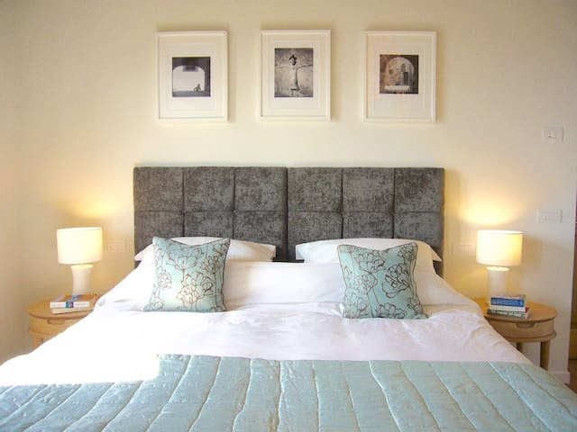 One of the four bedrooms. All with luxury bedding and Kingsize beds which split to twins if needed