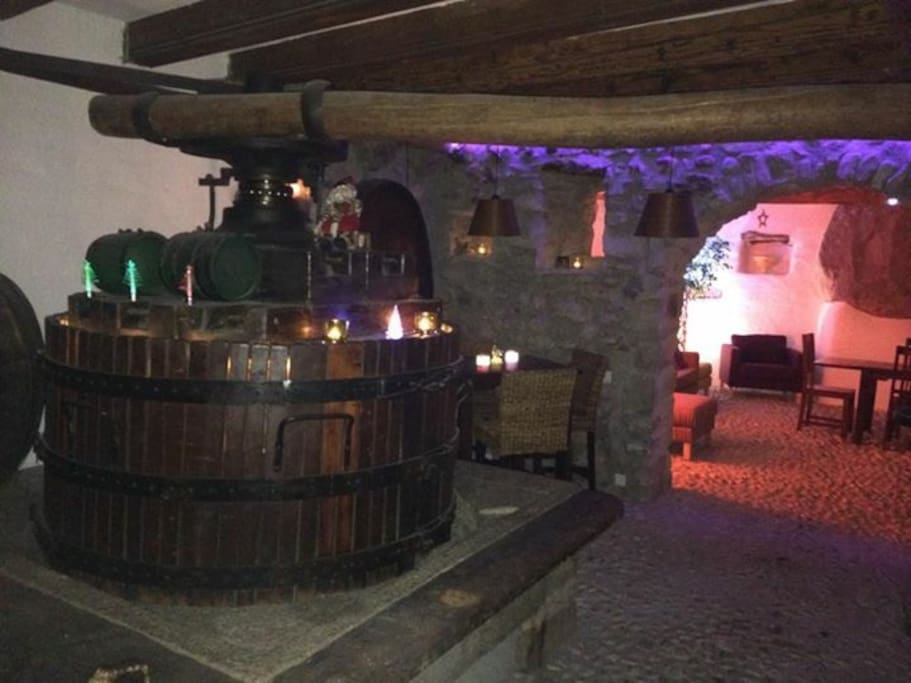 Wine cave with original wine press, first floor