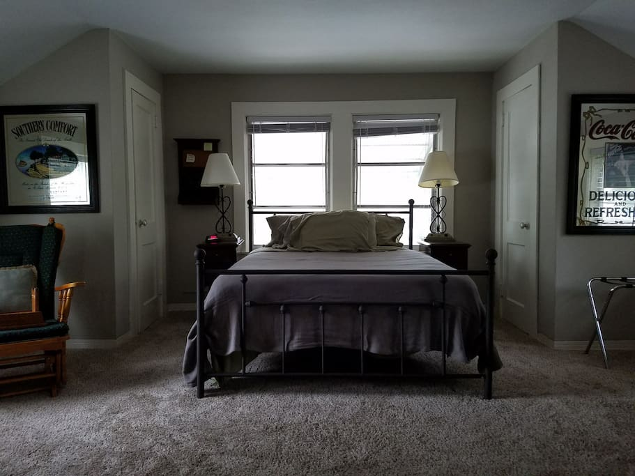 Spacious room with queen size bed.