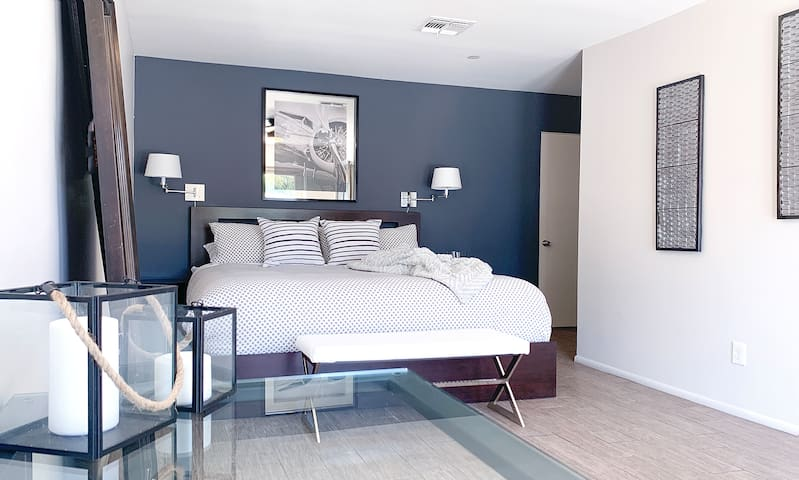 Expansive 2nd master suite features plush king sized bed, full bath, and double doors to the back yard.