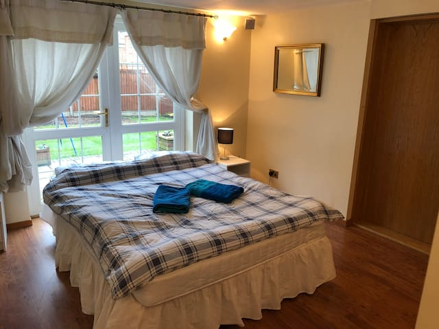Enjoy your rest in the bedroom with garden view.