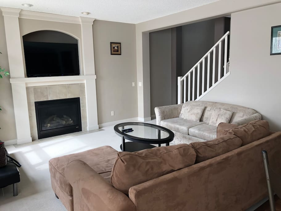 Living Room with 65 inch TV with Netflix and Cable