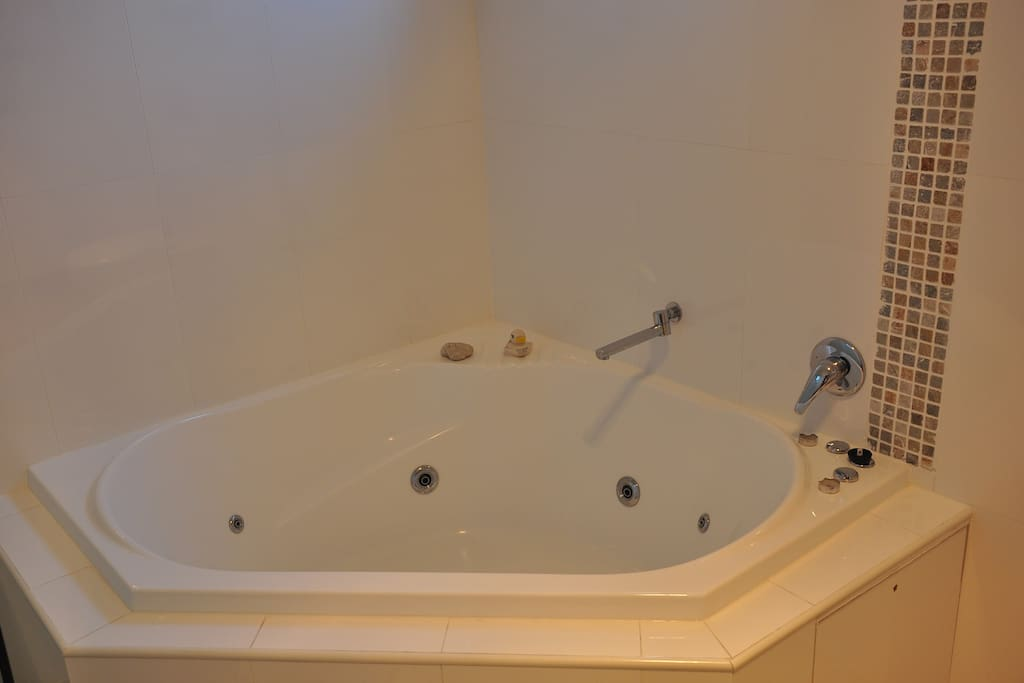 En-suite bathroom with spa and shower separate to spa
