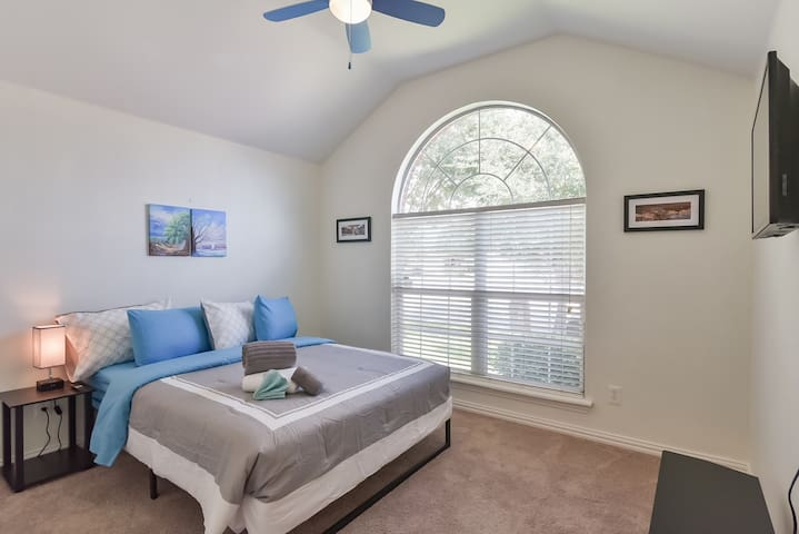 Third Bedroom with a view to the front of the home and a ton of space throughout!