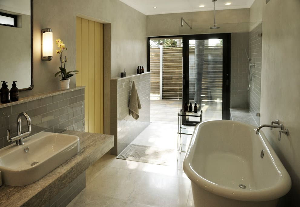 Largest of our bathrooms with freestanding bath and walk-in shower opening to your private deck.