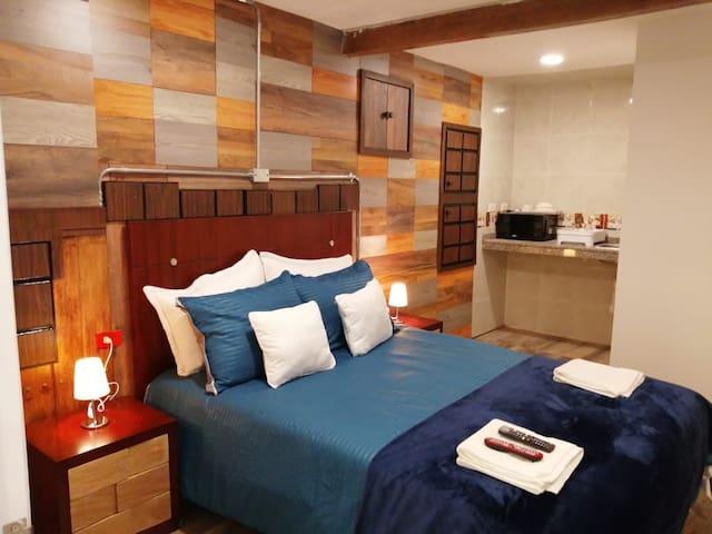 Hotel habitación con cocina y baño privado hermosa