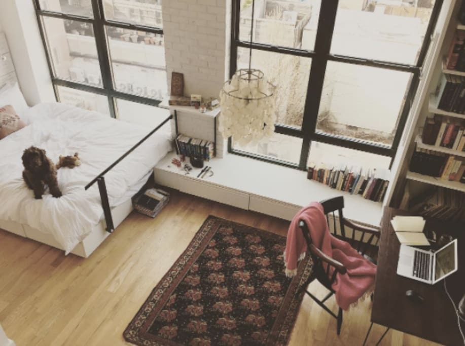 Looking down at our loft / bedroom from the stairs taking you to our private 900 sq ft roof!