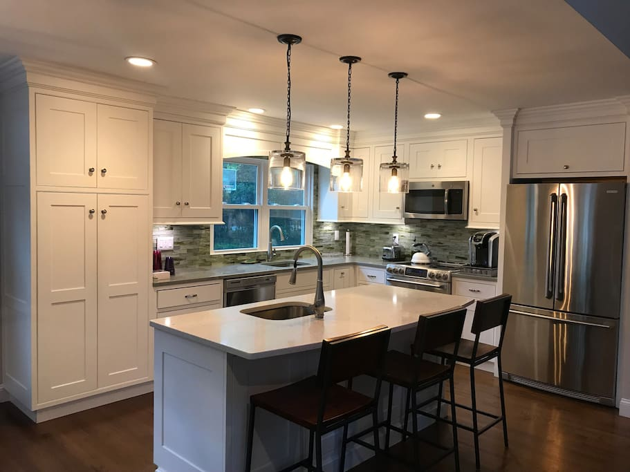 Gourmet Kitchen with stainless steel appliances, Caesar-stone countertops and eat-in island.  Fully stocked Keurig machine