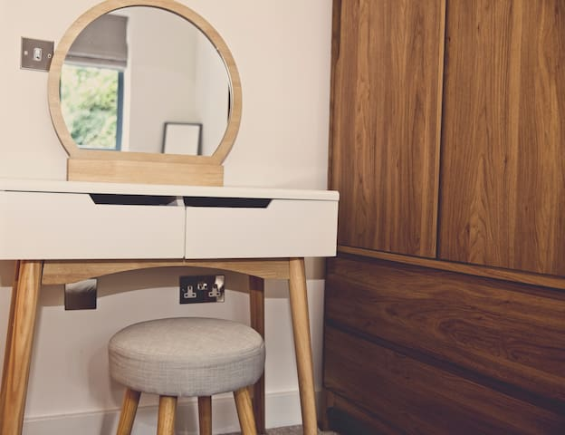 Dressing table in larger bedroom.