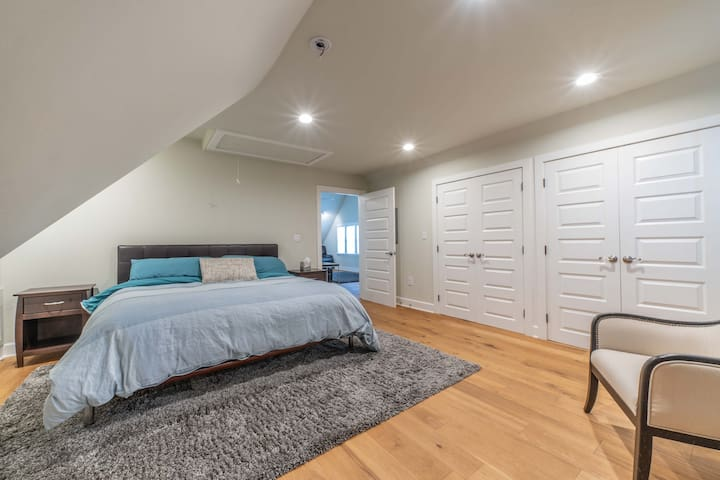 2nd Level Master Bedroom - Large bedroom with king bed, full length mirror, sitting area, and HUGE closet. (Double doors in photo are entrances to closet)