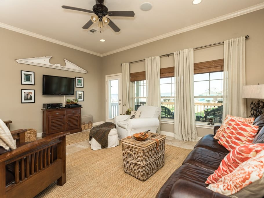 Gather in the living room on the comfortable sofa and chairs.