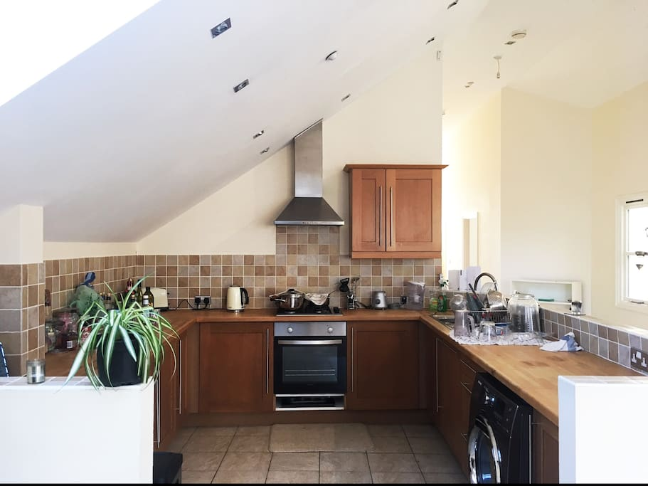 Super huge kitchen filled with plenty of useful amenities - washing machine, dishwasher, blender..