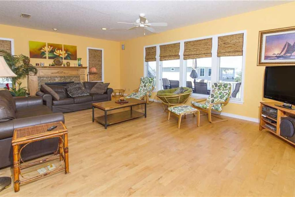 Spacious Living Room - Serenity Now has large comfortable couches, cable HDTV, and a cooling ceiling fan so that you can enjoy yo