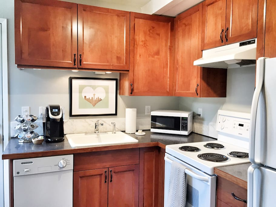 Fully stocked kitchen with dishwasher,  microwave, all utensils and small appliances