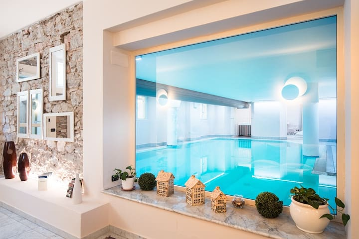 Apartment with sea view + indoor swimming pool