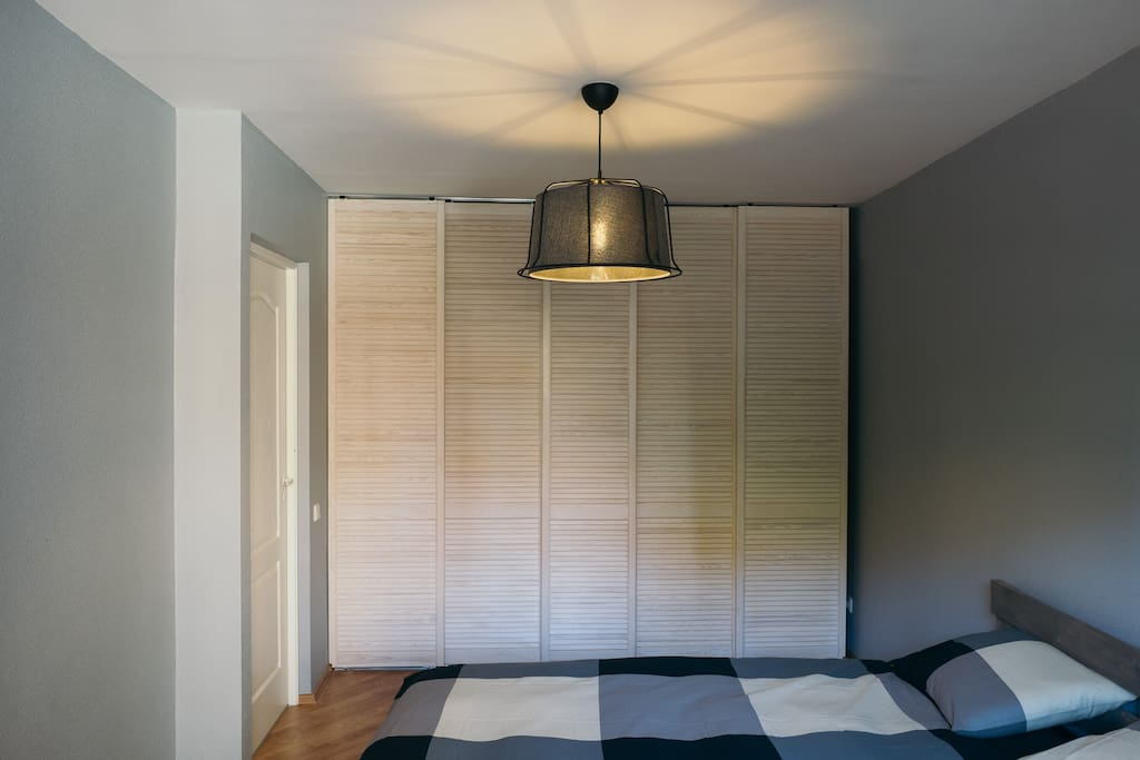Bedroom with wardrobe and double bed.