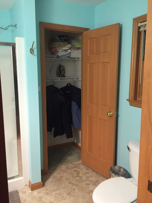 Closet with iron, hair dryer ,towels & hangers