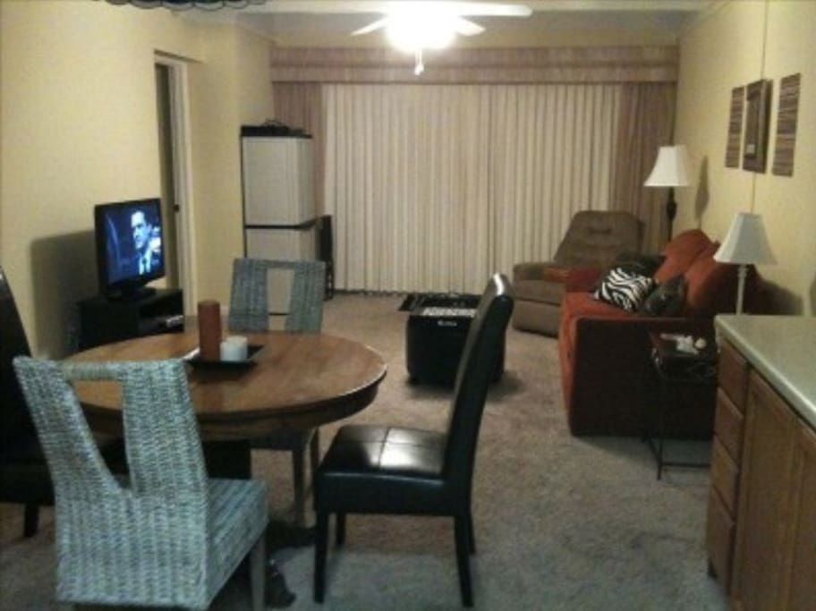 Kitchen opens to living room.  Sofa pull out to full bed.  Flat screen TV with cable.