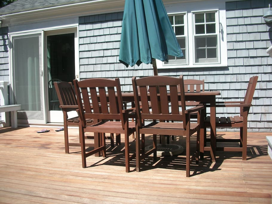 Back deck in early afternoon. Mahogany floor with surround built in benches.