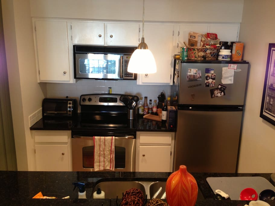 View of the kitchen. All stainless steel appliances and granite countertops.