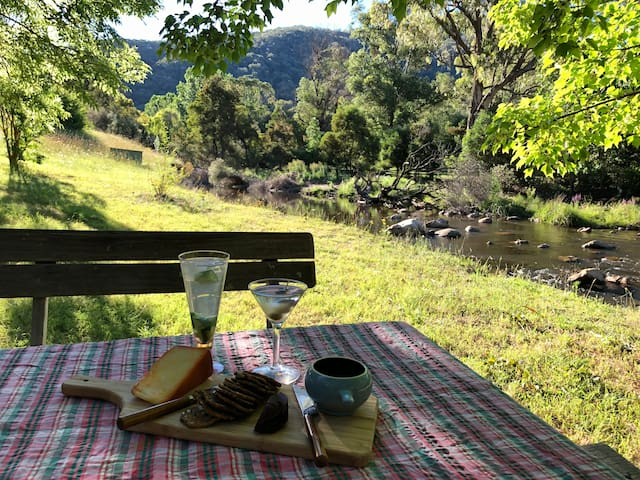 Afternoon aperitifs at the picnic table by the creek.