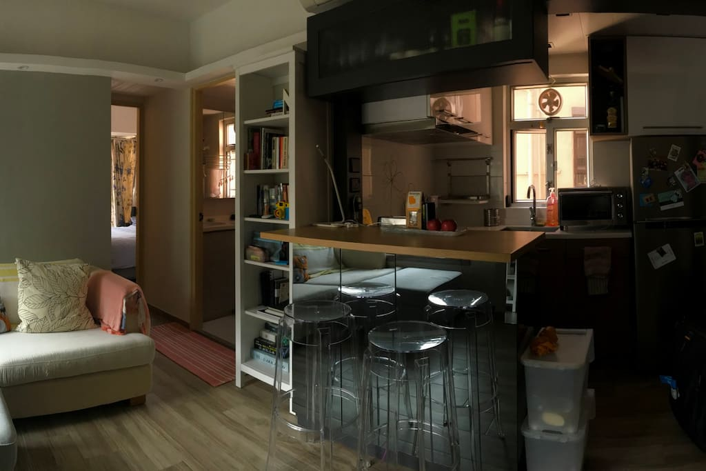 Panorama shot of the living room, bar and kitchenette