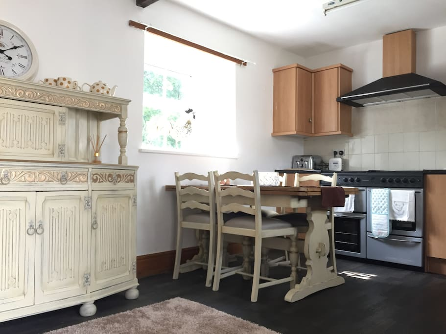 Kitchen with dining table. All essentials including washing machine and tumble dryer