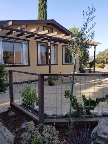 Front of the ranch house, pergola and sitting area. Grape vines, lavender and rosemary line this sitting area.
