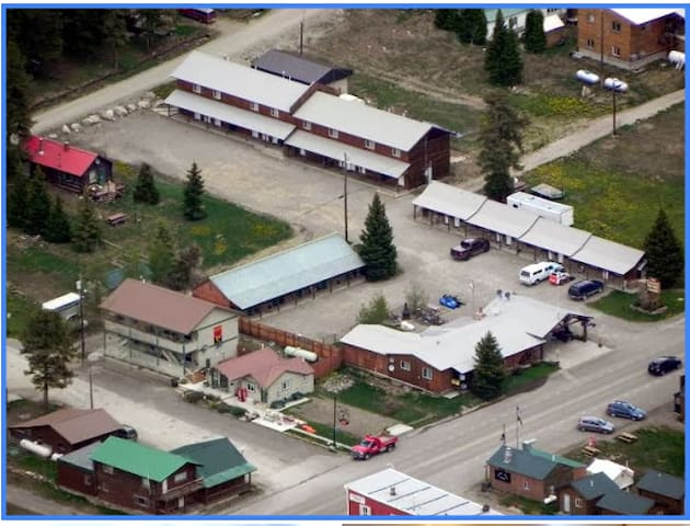 Aerial view, cabin far left corner (red roof).