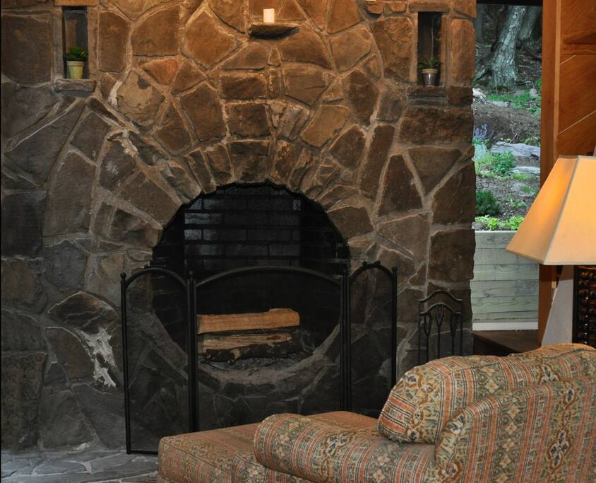 The hand-built stone fireplace