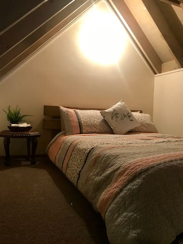 Cozy and luxurious comfy queen bed awaits after your day in the snow!