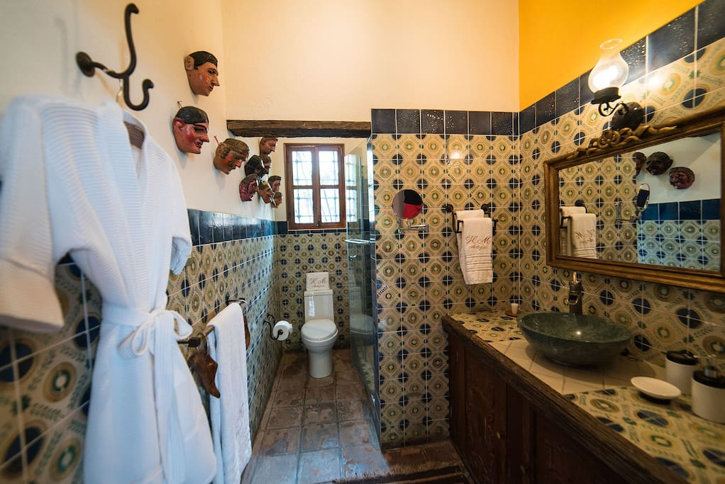 Your bathroom features handpaitned tiles, tempered glass shower, hairdryer, bathrobes, a magnifying mirror among other comforts.