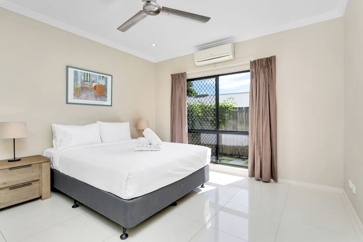 In the third bedroom, rest easy in a premium queen-sized bed. All bedrooms feature ceiling fans and air-conditioning for a good night's sleep.