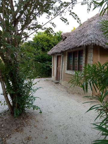 Swahili house with private bathroom decorated with shells ,honeymoon room