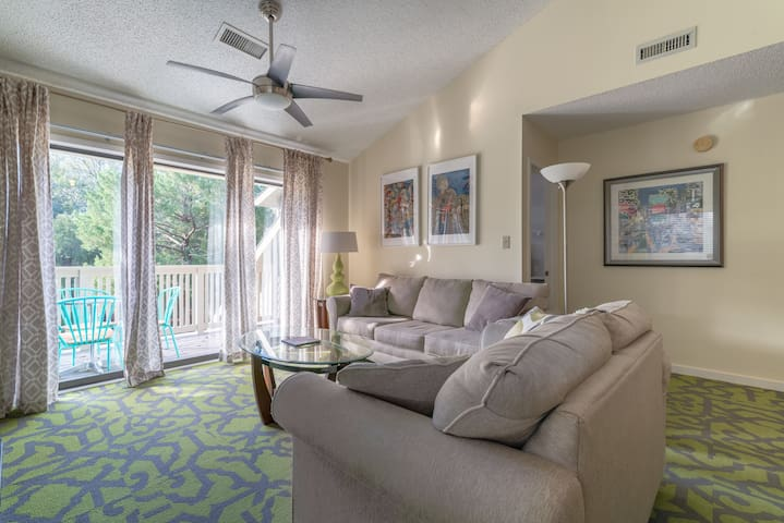 comfy living room furniture with a queen size sofa mattress....comfortable seating for six..access to the open air deck right outside and a view of the waterway.
