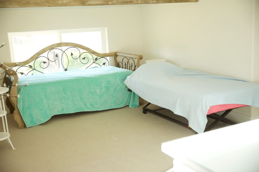 Upstairs bedroom with two twins that convert to king