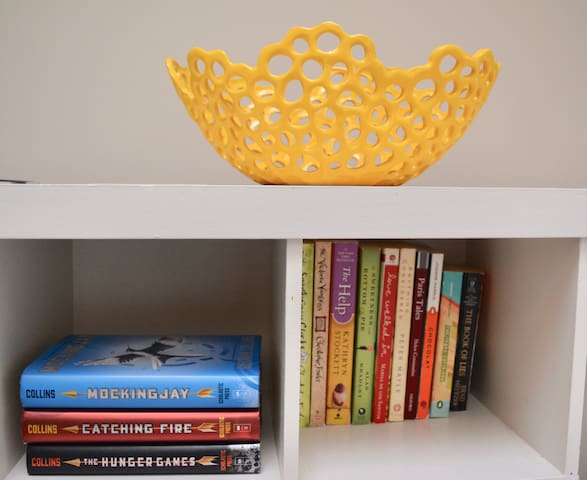 The Yellow Bowl. The shelves below are filled with books and games.