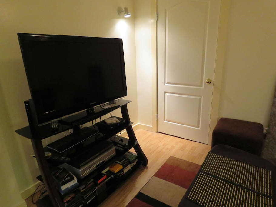TV and door to bedroom