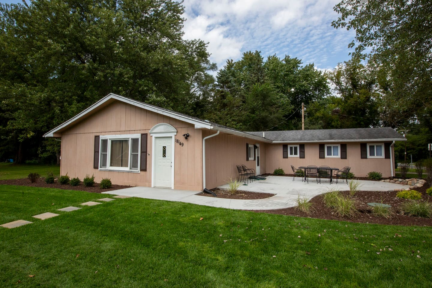 Front of home with big yard and great patio space